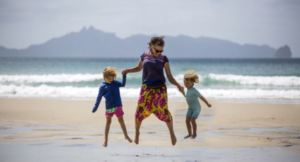 Woman with two children at beach