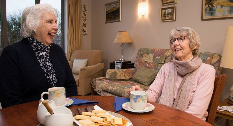 Village residents enjoy afternoon tea.